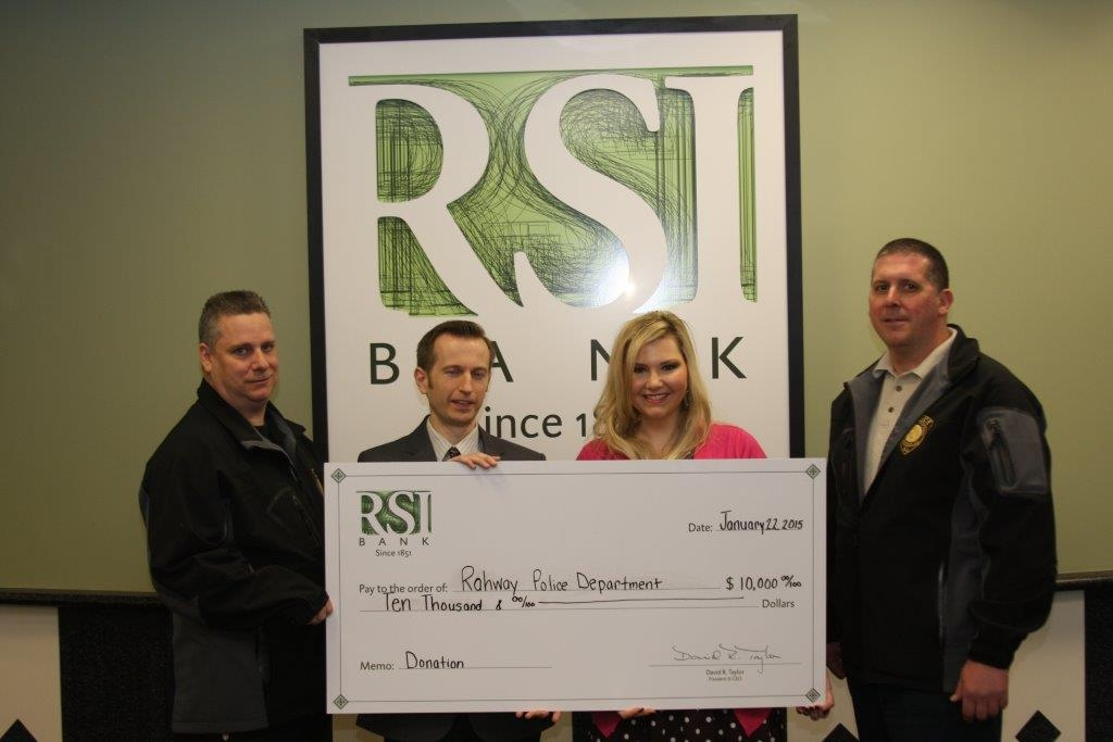 Pictured (from left to right): Det. William Eicholz, RSI Bank Branch Administrator Brian Dwelle, RSI Bank Vice President of Corporate Communications Sonya Solenske, and Det. Captain Joseph Simonetti.